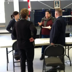 Lawyers Anne Sabourin (far left) and David Donnelly confer with Chief Phyllis Williams and Melissa Dokis of Curve Lake First Nation.